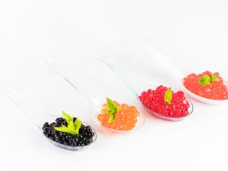 An example of molecular gastronomy. Caviar on four different spoons.