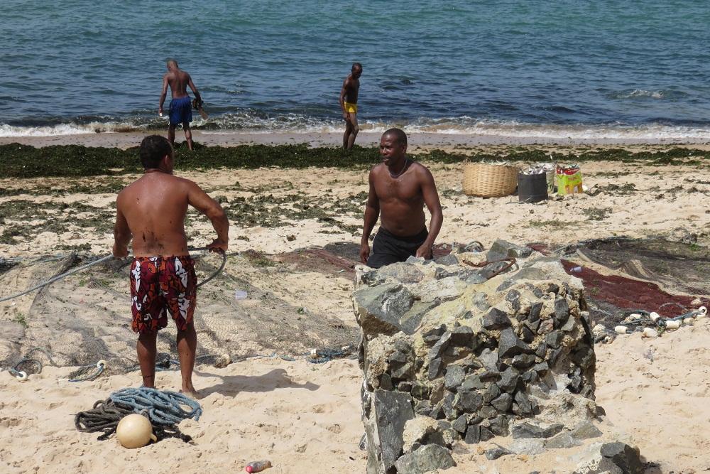 Salvador Fishermen mending their nets