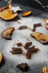 sugar powder, star shaped cookies, orange peels