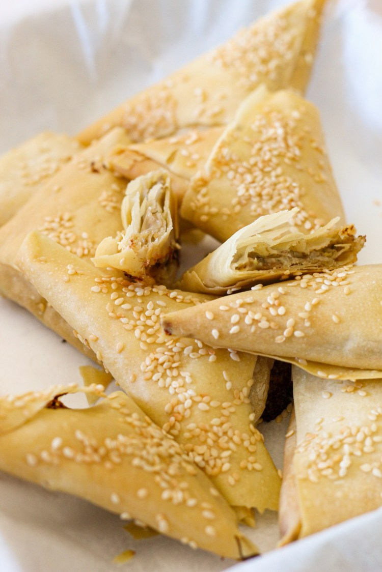 mushrooms, goat cheese, mozzarella, pastry dough sheets, sesame seeds