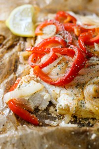 two pieces of feta cheese with red bell peppers, onions, oregano, olive oil, wrapped in parchment paper and bbq on the grill for a smokey taste.
