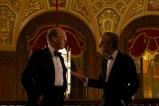 WORTH (2021), Michael Keaton as Kenneth Feinberg and Stanley Tucci as Charles Wolf. Cr Monika Lek / Netflix