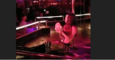 Well This Is New. Stripper Collects Money On Stage While Eating A Pizza.
