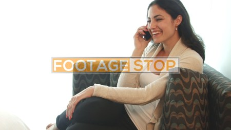 ethnic-business-woman-using-mobile-device-stock-footage