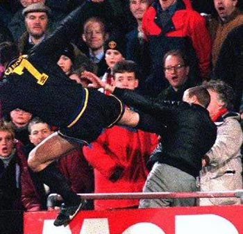 Manchester United star Eric Cantona kung fu kicks a Crystal Palace supporter.