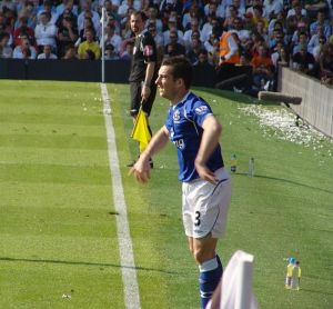Leighton Baines' late penalty gave Everton a 2-1 win over Wolverhampton Wanderers at Goodison Park.