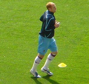 Aston Villa defender James Collins will miss Sunday's clash with Manchester United