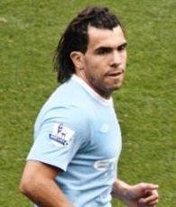 Manchester City striker Carlos Tevez doesn't really want Manchester United boss Sir Alex Ferguson to die