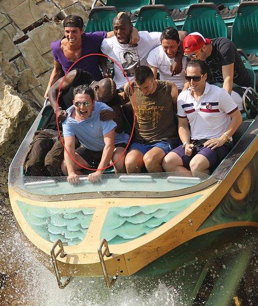 Mario Balotelli rides the log flume at a theme park near Verona, Italy