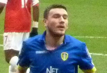Robert Snodgrass playing for Leeds United against Arsenal in the FA Cup