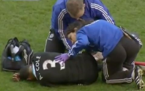 Chelsea physio Eva Carneiro attends to Ashley Cole during their match against West Brom