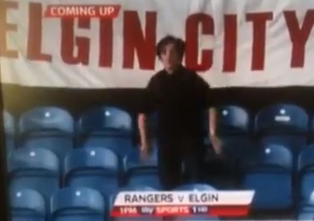 A female Elgin City fan dances during their match against Glasgow Rangers at Ibrox