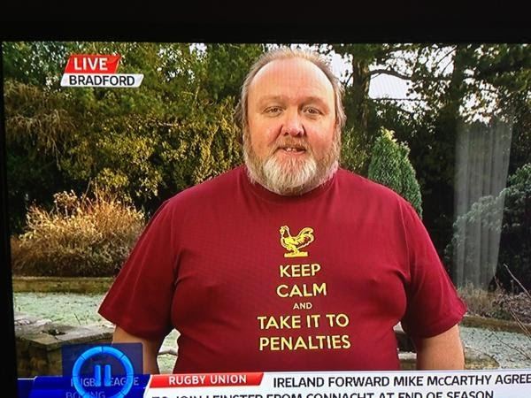 Bradford City chairman Mark Lawn wears a 'Keep Calm And Take It To Penalties' t-shirt for a Sky Sports interview following his club's Capital One Cup win over Arsenal
