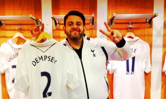 Man v Food presenter Adam Richman holds Clint Dempsey shirt during a tour of Spurs' White Hart Lane stadium