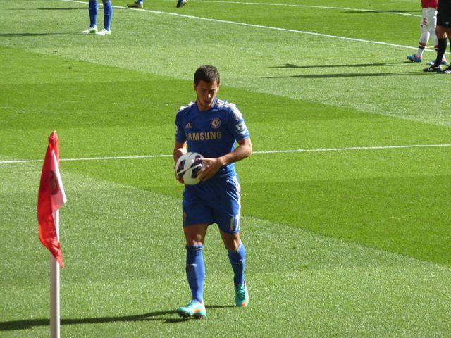 Hazard kicks ball boy