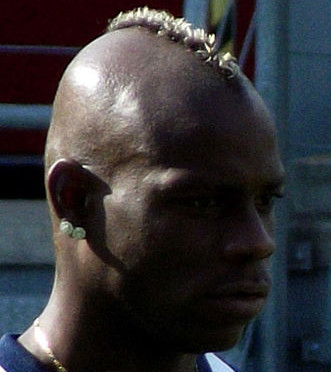 Mario Balotelli, pictured at Euro 2012, had his dinner with AC Milan vice-president Adriano Galliani gatecrashed by fans