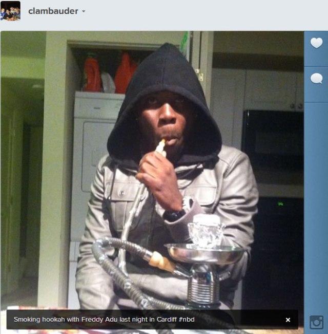 Freddy Adu smokes a hookah in Cardiff, Maryland