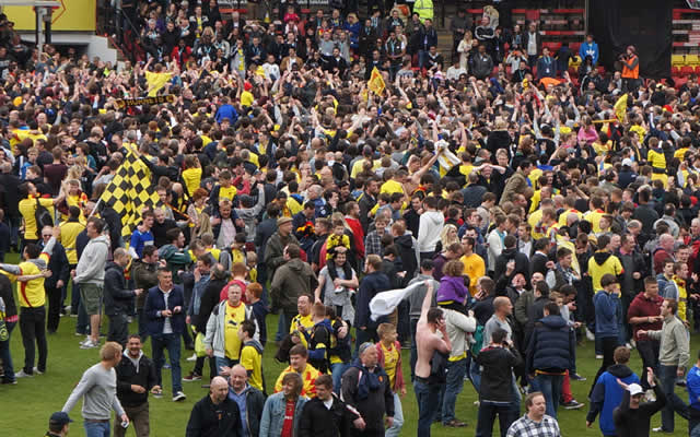 Fans invade the pitch after a dramatic end to the Watford v Leicester City play-off semi-final second-leg