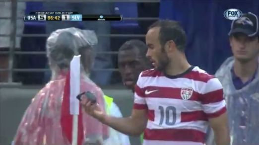 Landon Donovan wears sunglasses after El Salvador fans throw a pair at him