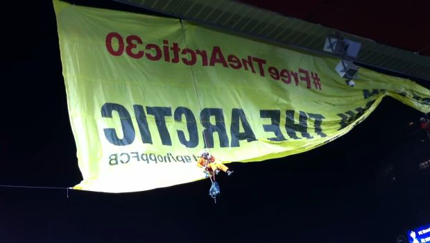 FC Basel v Schalke 04 Greenpeace protesters abseil down from roof during Champions League match at Joggeli