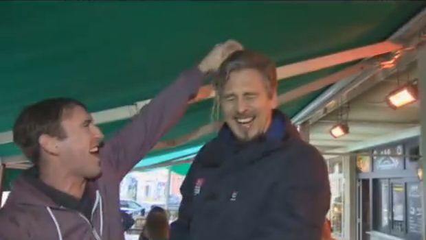 An Irish fan pours beer on a German Sky Sports News reporter