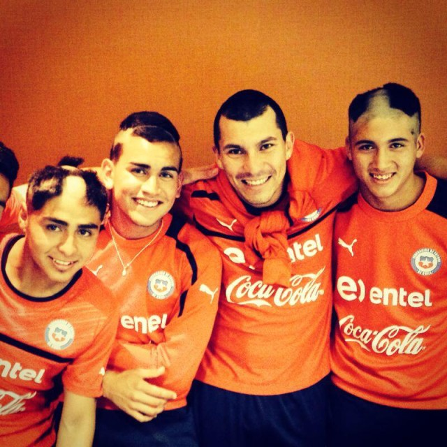 Gary Medel shows off the results of the Chile head shaving initiation
