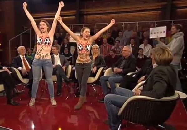 Topless FEMEN feminists storm Markus Lanz, a German football TV show, to protest against working conditions in Qatar
