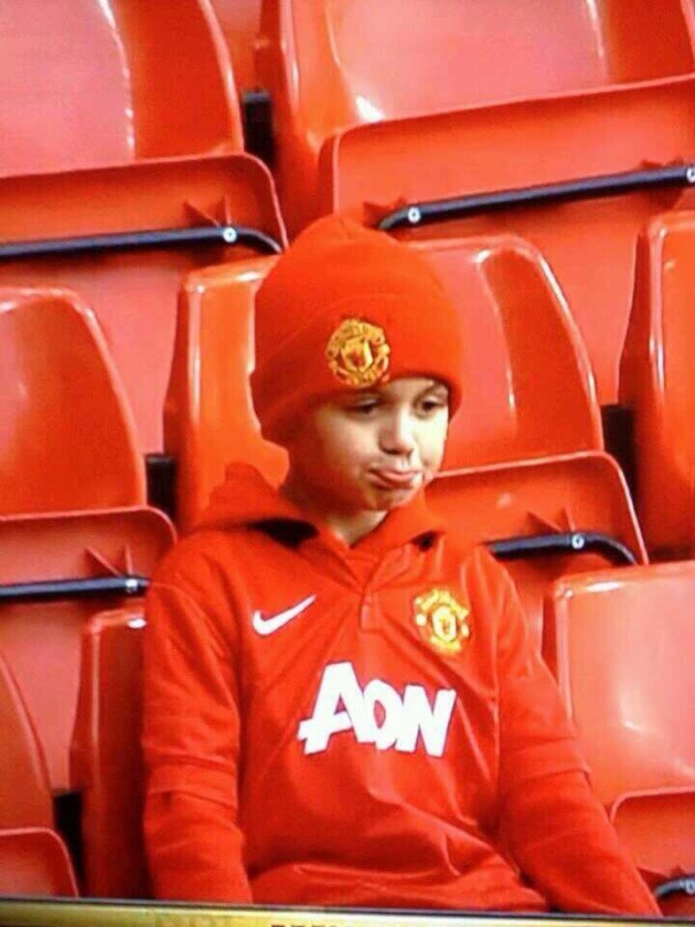 A sad fan, included in one of the best Manchester United jokes after their FA Cup loss to Swansea