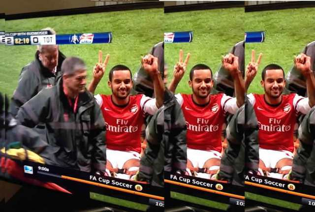 One of the Spurs fans'  Theo Walcott jokes after the Arsenal star suffered a cruciate ligament injury
