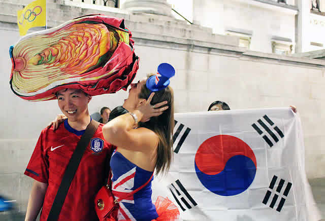 A South Korea fan shows his devotion to World Cup food