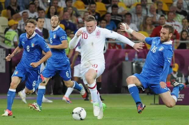 Seen here playing against Italy at Euro 2012, Wayne Rooney is named England captain by manager Roy Hodgson
