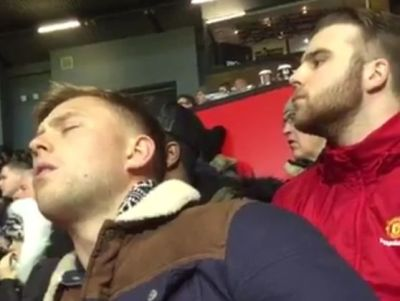 A Manchester United fan falls asleep during their 1- FA Cup third round win over Sheffield United at Old Trafford