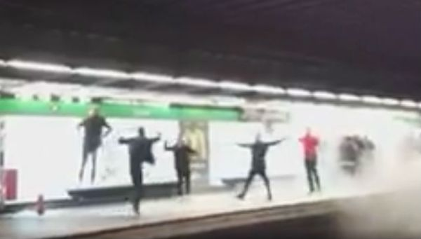 Arsenal fans let off a fire extinguisher on a Barcelona Metro platform