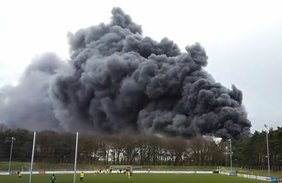 Amasya Lohne v BW Lusche match plays through a warehouse fire in the background