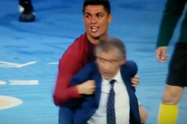 Cristiano Ronaldo manhandles Portugal coach Fernando Santos during Euro 2016 final