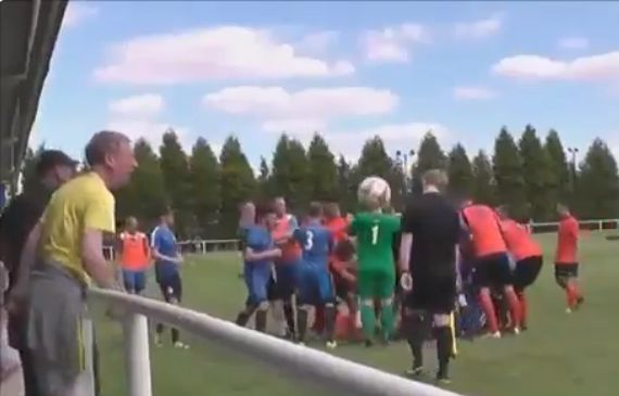 A fan hits assistant referee in head with ball in Hemsworth Miners Welfare's Emirates FA Cup extra-preliminary round win over Runcorn Linnets
