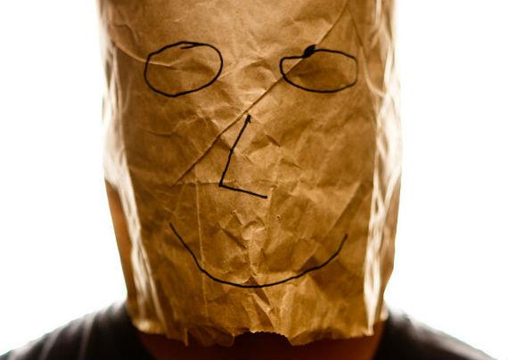 Is Gareth Southgate or Wayne Rooney under this paper bag?