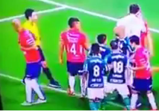A Uruguayan player rips his own shirt to get an opponent in trouble