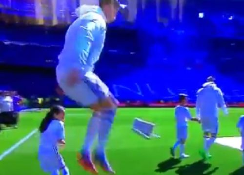 Cristiano Ronaldo scares mascot by jumping as they walk out of the tunnel together before Real Madrid 1-1 Atlético Madrid at the Bernabéu