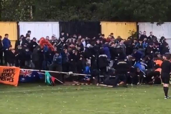 Prescot Cables fans collapse fence celebrating goal against Southport in Liverpool Senior Cup Final at Volair Park