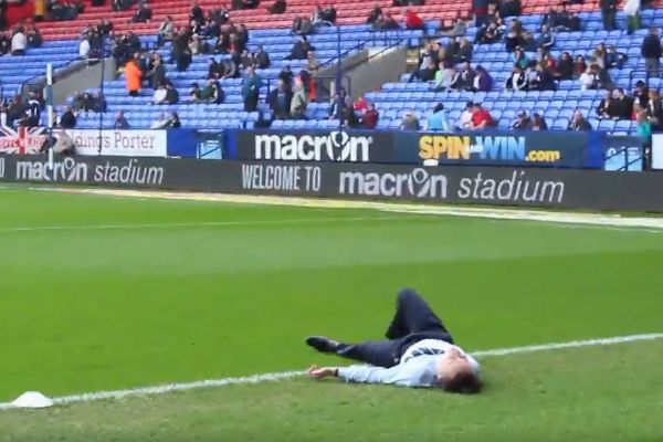 Bolton video editor slips kicking the ball back to the players as they warm up before clash with Chesterfield