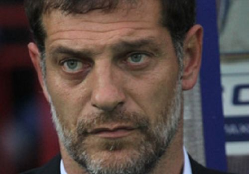 Slaven Bilić looking at something, but probably not the jokes after West Ham 0-3 Brighton