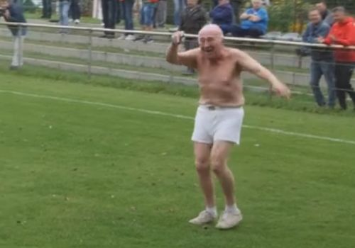 Topless elderly pitch invader interrupts a German lower league game between FC 98 Hennigsdorf and FSV Babelsberg 74