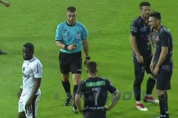 Referee István Kovács sprays vanishing spray in a player's face in a Romanian Cup semi-final
