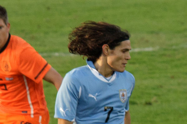 Two Edinson Cavani goals saw Portugal go out of the World Cup to Uruguay.
