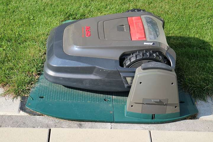 A robotic lawnmower on its stand