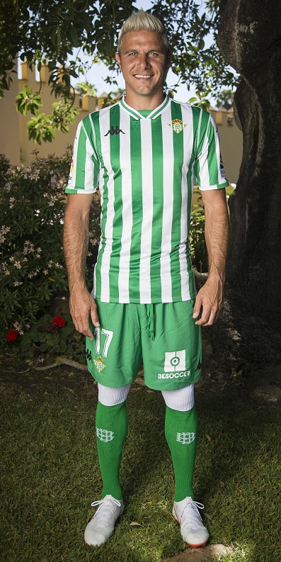 a676d59664b A ribbed v-neck collar in green and white with a neck insert at its front  adds a classic football kit feel to the jersey.