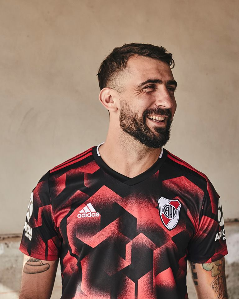 05aca5248e1 The River Plate 2019 third kit features a modern design on its front made  up red and black shapes and grafitti-inspired spray paint effects.