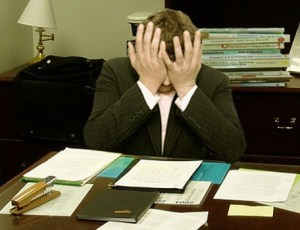 man-stressed-at-work-desk-456x350 - NFL Pay