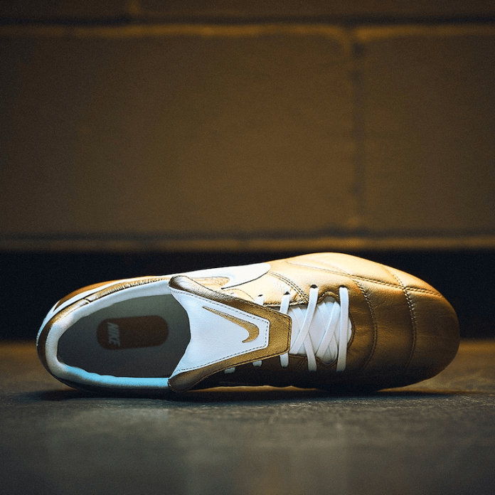 gold nike boots